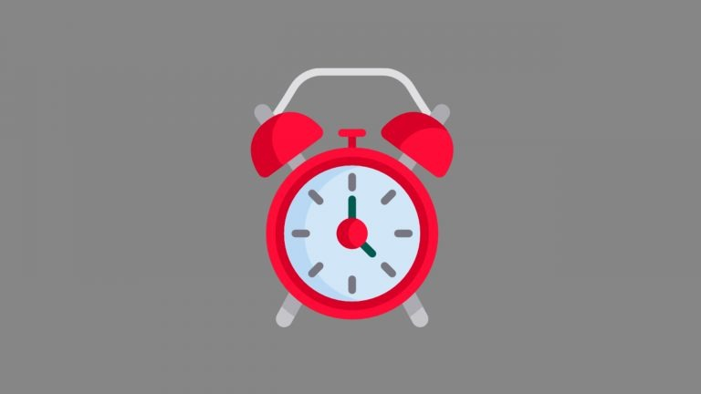 A red and white cartoon alarm clock sits on a dark grey background. The image conveys that the post will discuss how long you should talk for in IELTS Speaking Part 1