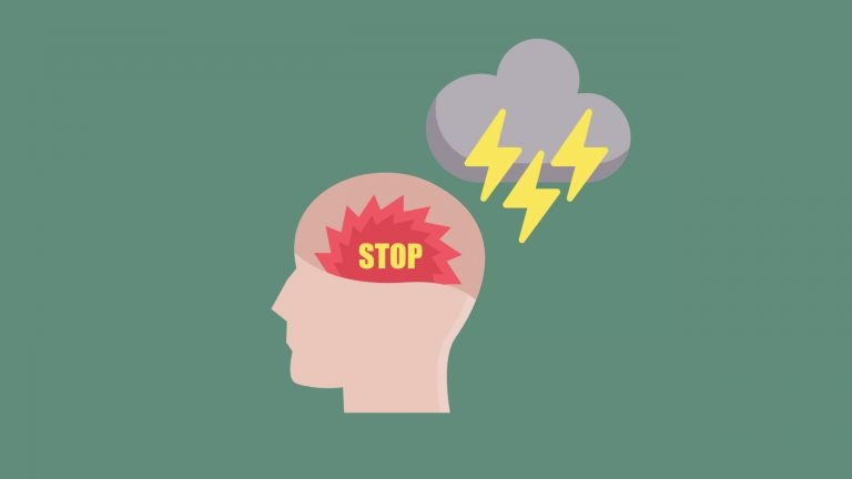 The side view of a head with a red saw in it sits on a great background with a thunder and lightning cloud about it signifies IELTS Speaking Tips - 5 things no IELTS examiner wants to hear